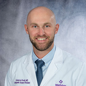 A headshot of Dr. Cameron Dodd