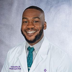 A headshot of Dr. Uzoma Nwakibu