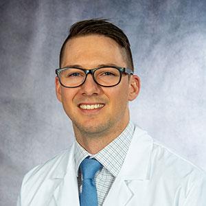 A friendly headshot of Dr. Derek Duey