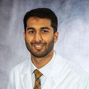 A friendly headshot of Dr. Naqeeb Faroqui