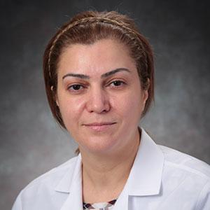 A friendly headshot of Dr. Seham Al-Haddad