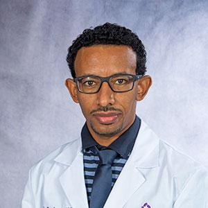 A friendly headshot of Dr. Tariku Assen