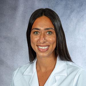 A friendly headshot of Dr. Katherina Zakka