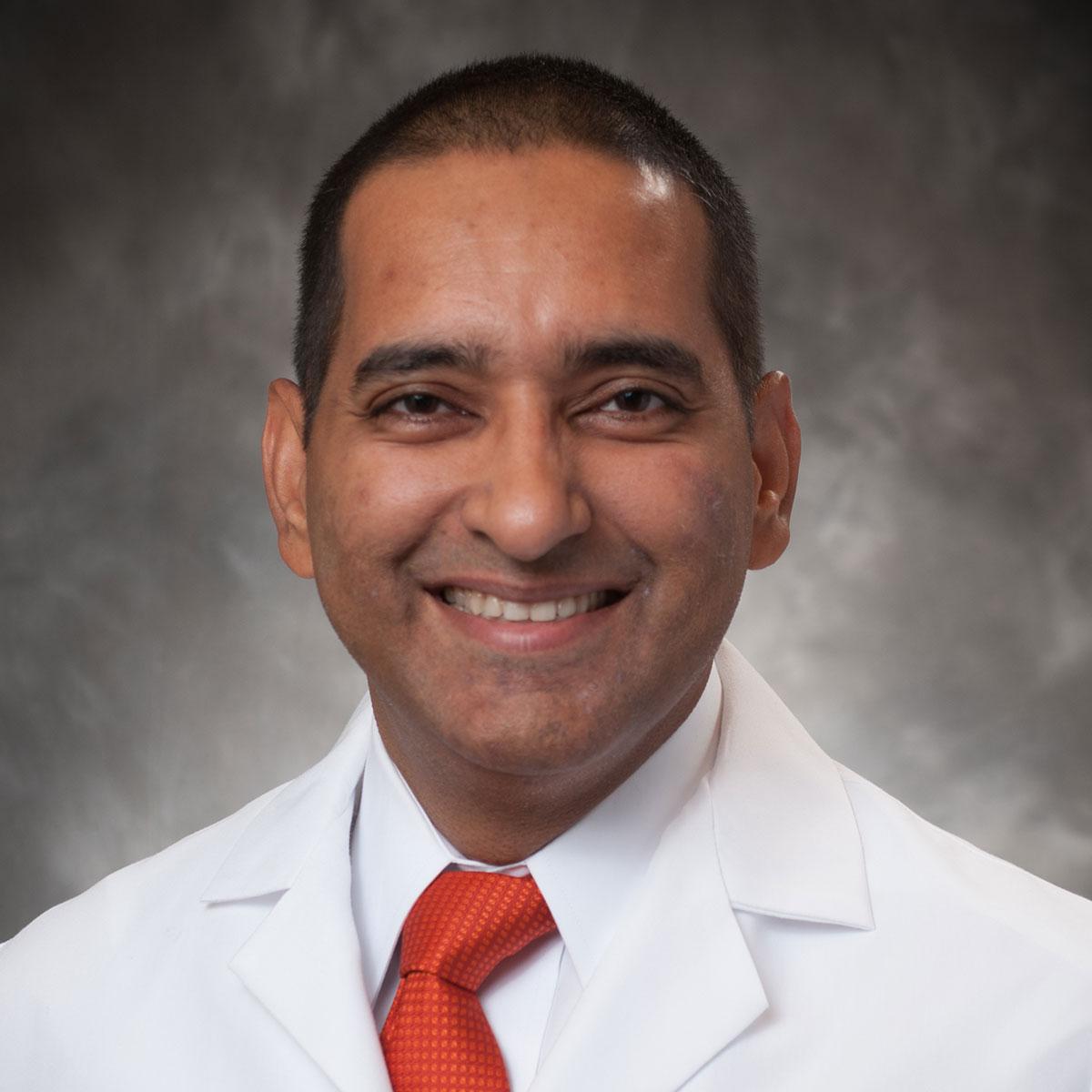A friendly headshot of Dr. Asif Saberi