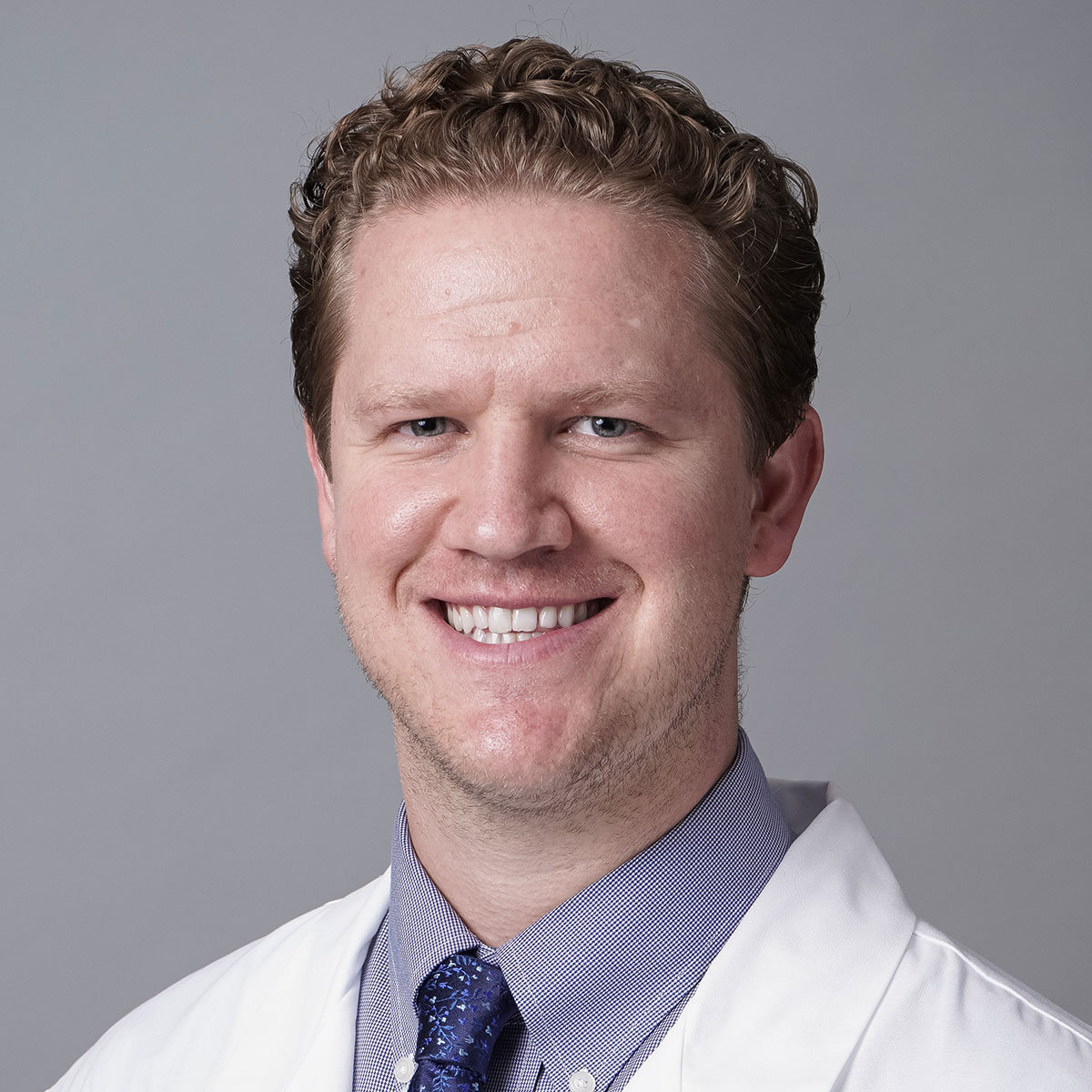 A friendly headshot of Dr. Cameron Kennelly