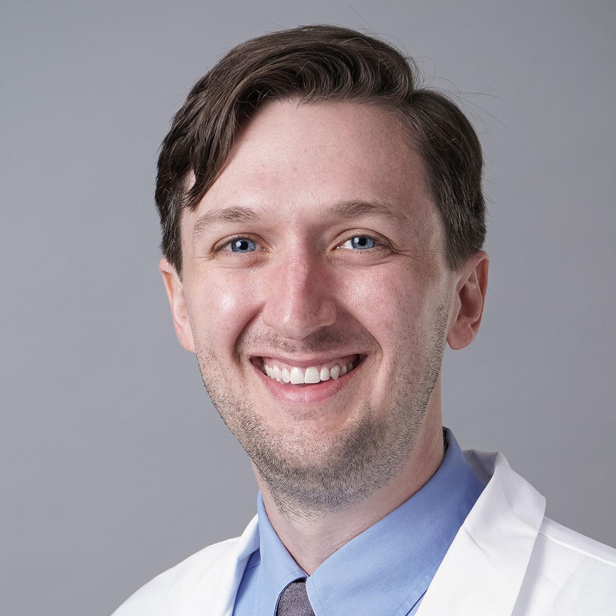 A friendly headshot of Dr. Clay Rowe