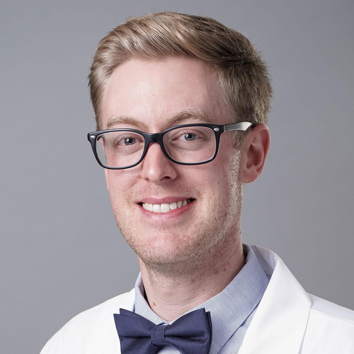 A friendly headshot of Dr. Lucas Hopkins