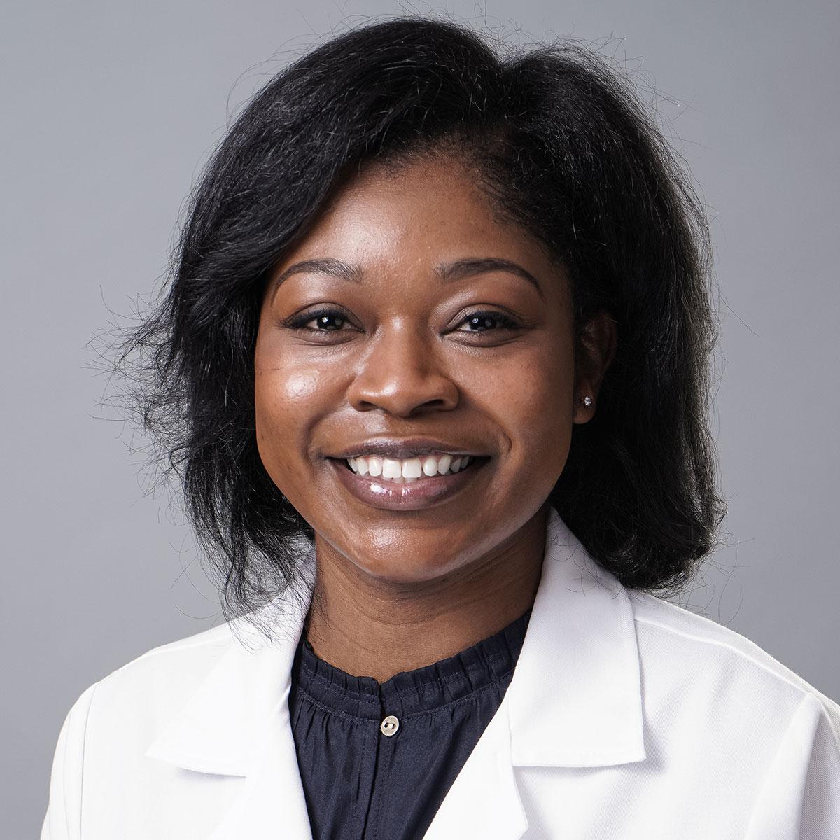 A friendly headshot of Dr. Tyesha Coleman