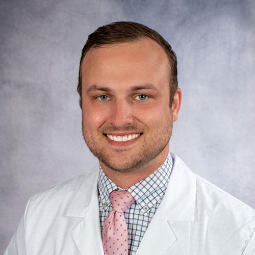 A headshot of Dr. Caleb LaVigne