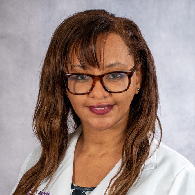 A friendly headshot of Dr. Beza Assefa