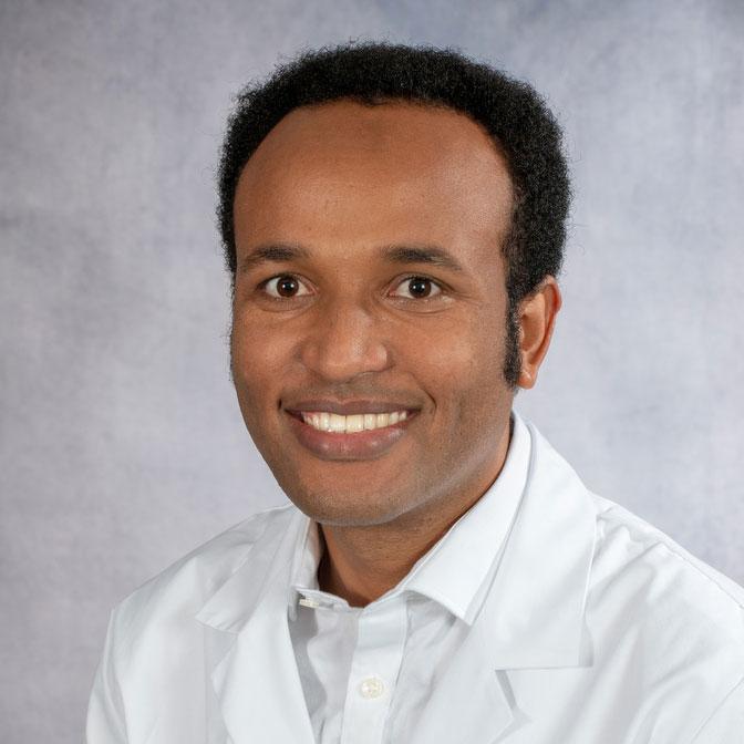 A friendly headshot of Dr. Yihienew Bezabih