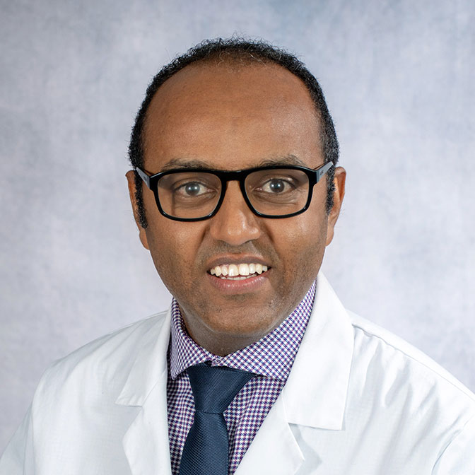A friendly headshot of Dr. Noah Dessalegn