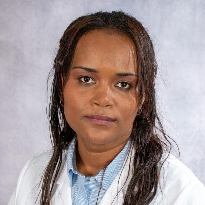 A friendly headshot of Dr. Adi Gichamo