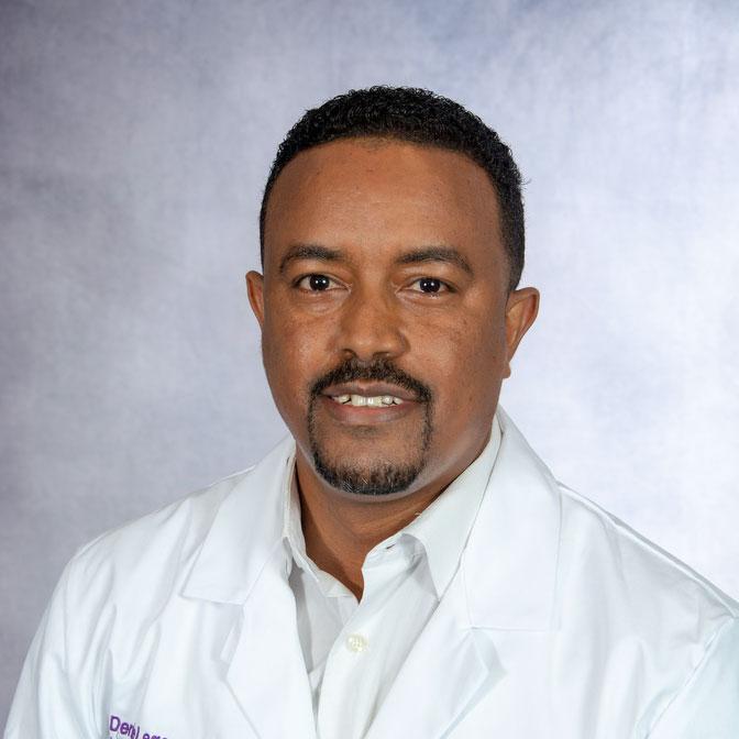 A friendly headshot of Dr. Dereje Legesse