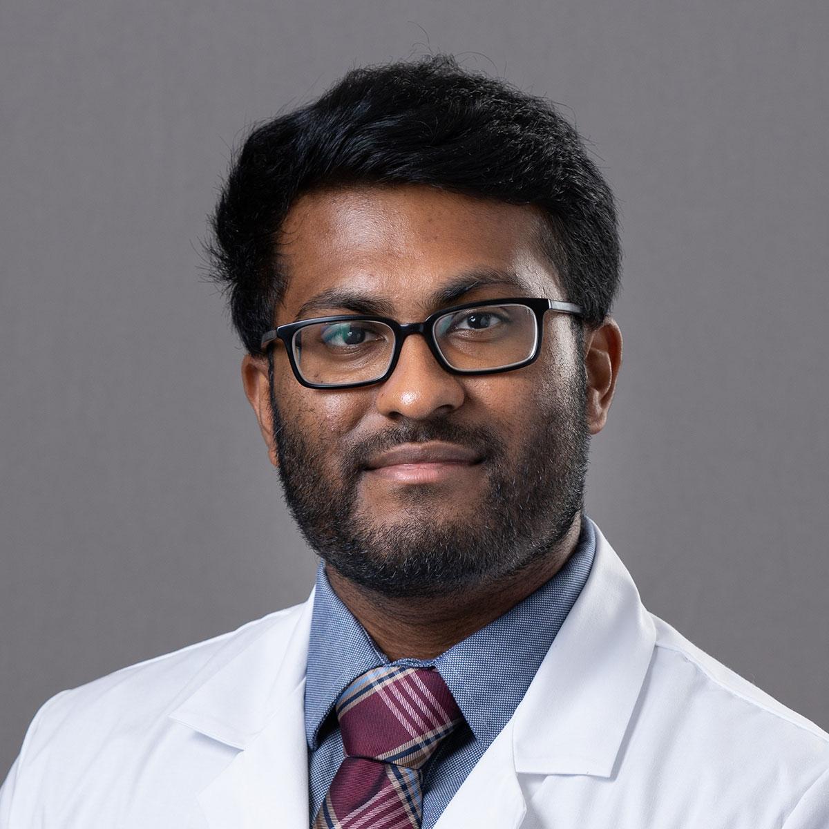 A friendly headshot of Dr. Aditya Reddy