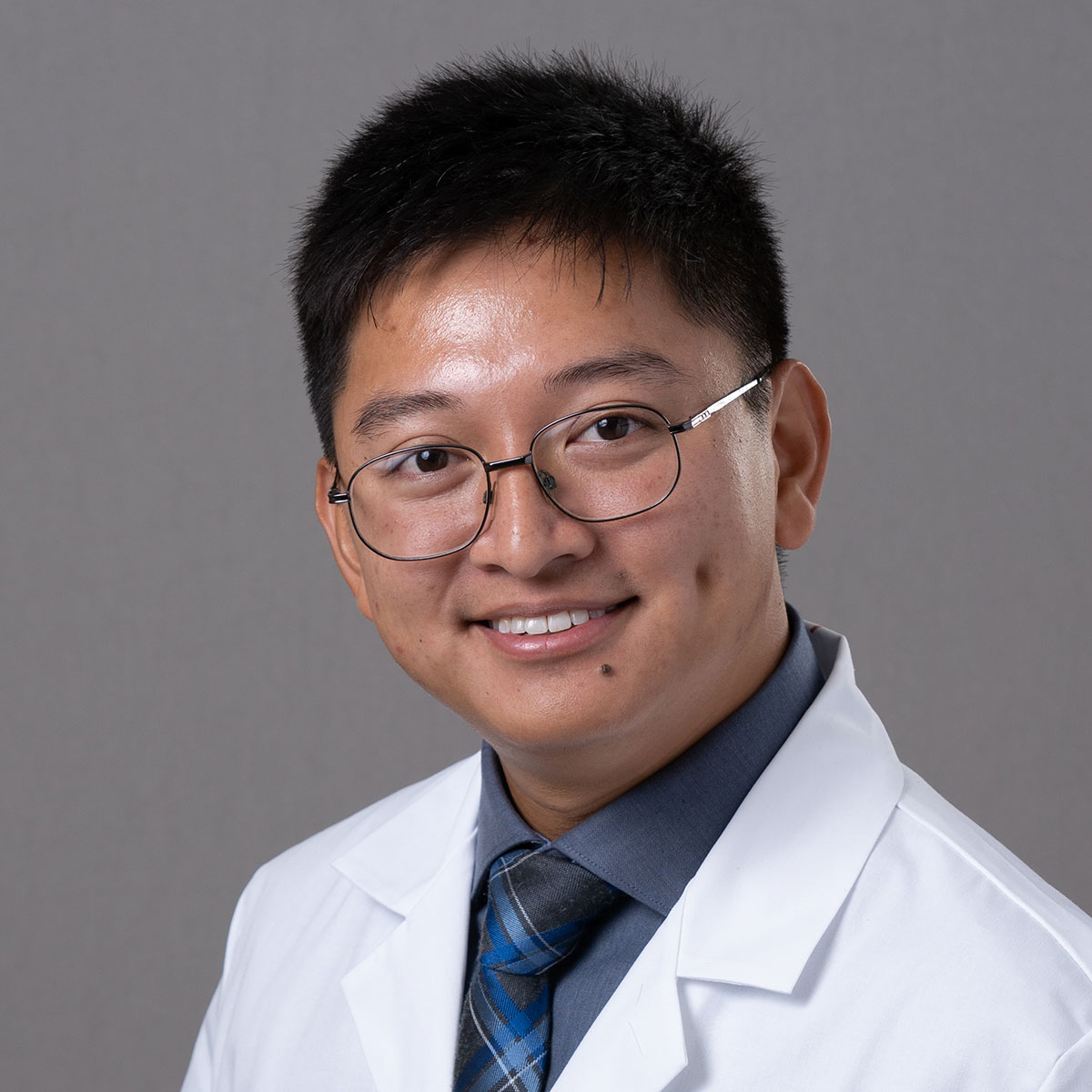 A friendly headshot of Dr. Anh Le