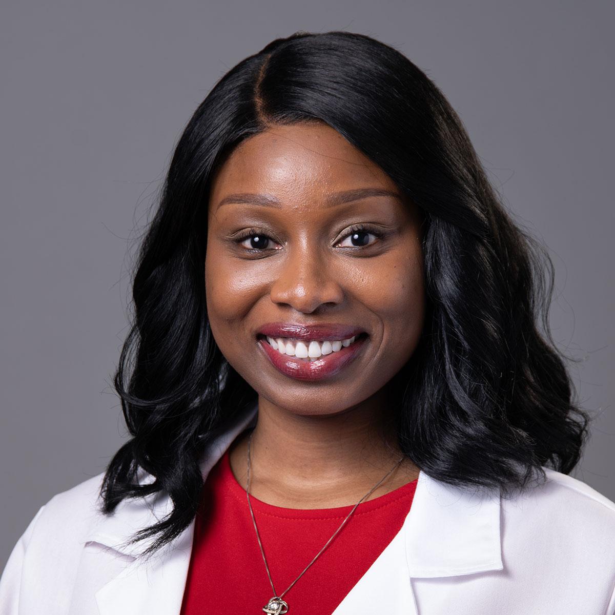 A friendly headshot of Dr. Ashley Aisabor