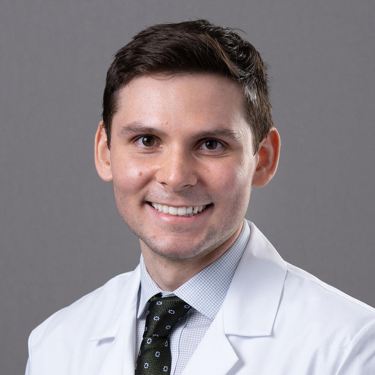 A friendly headshot of Dr. David Lakomy