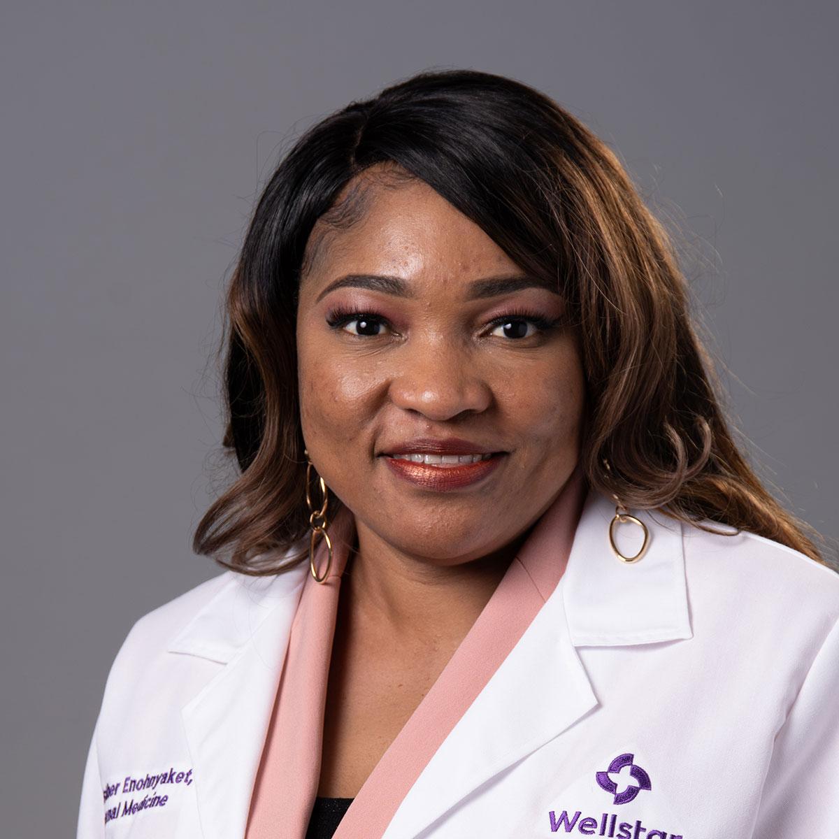 A friendly headshot of Dr. Esther Enohnyaket