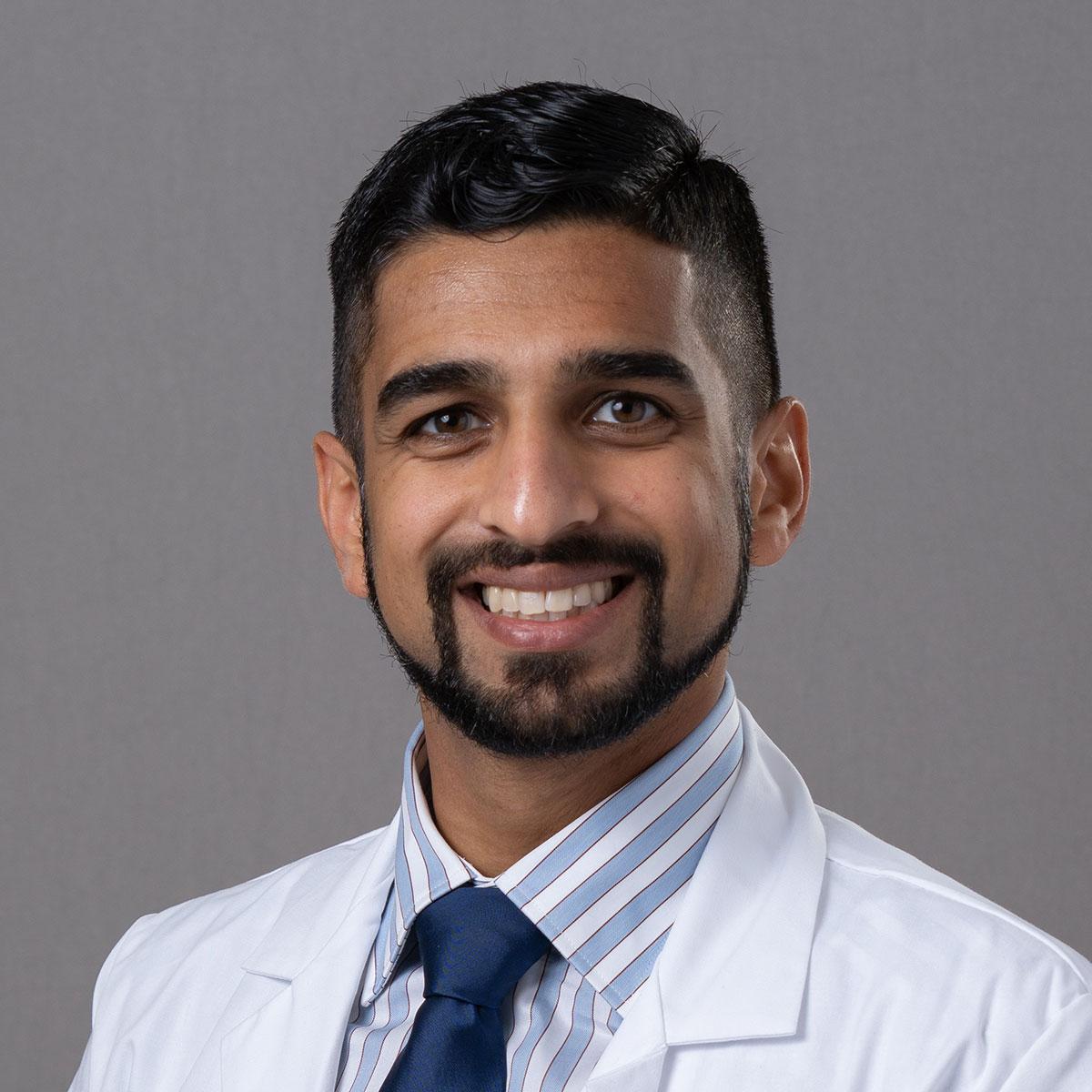 A friendly headshot of Dr. Faraz Ahmed