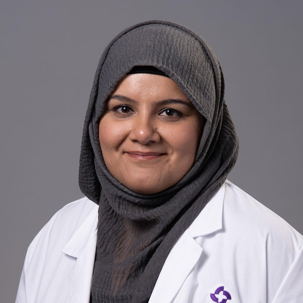 A friendly headshot of Dr. Javeria Naz