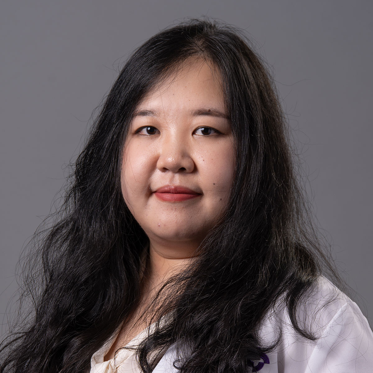 A friendly headshot of Dr. Jiaqi Mi