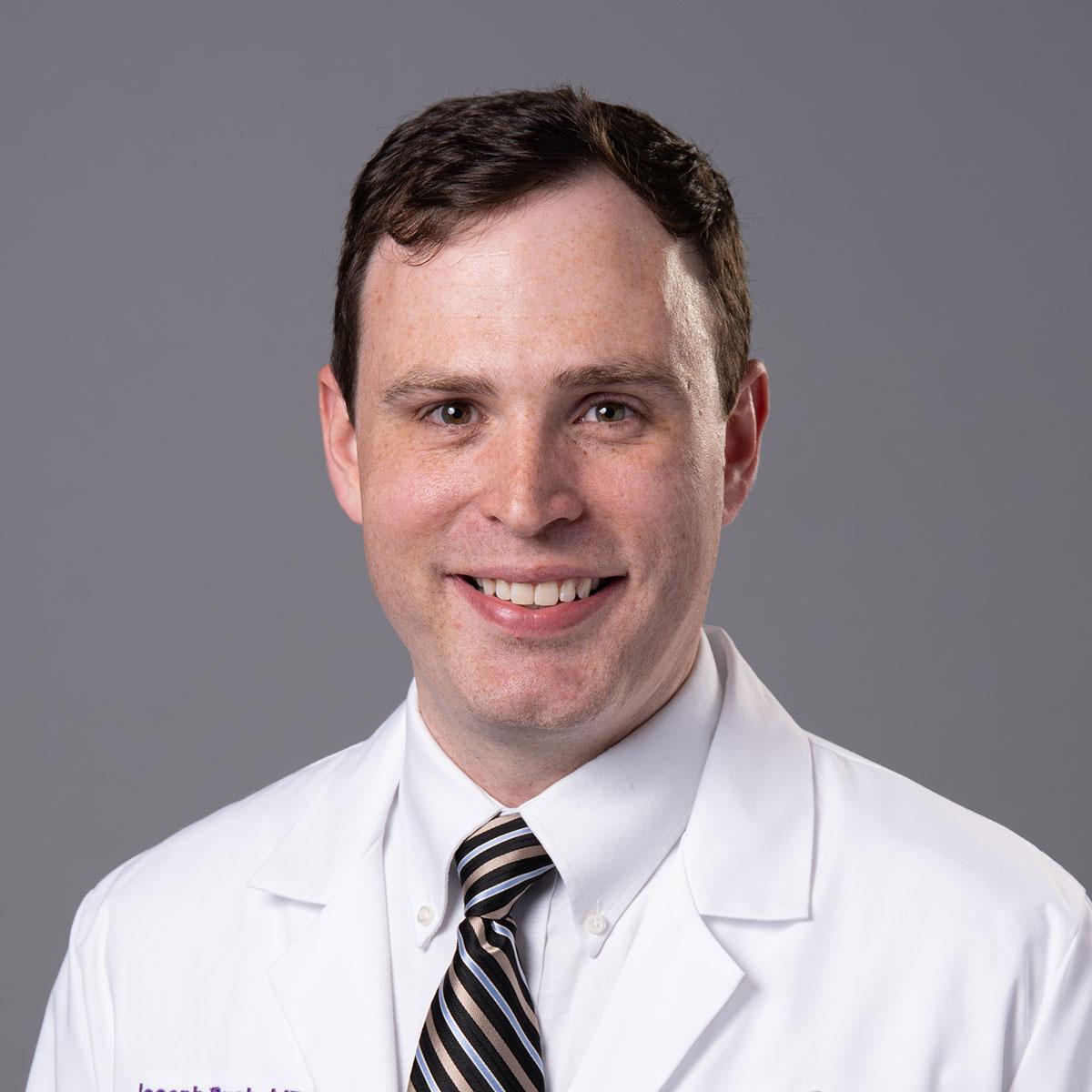 A friendly headshot of Dr. Joseph Bush