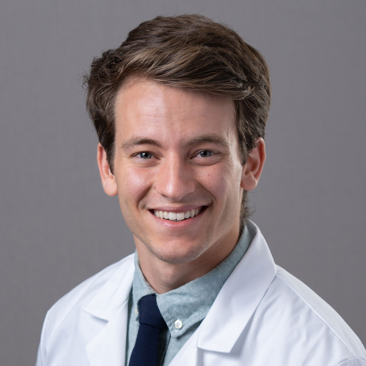 A friendly headshot of Dr. Karson Mostert