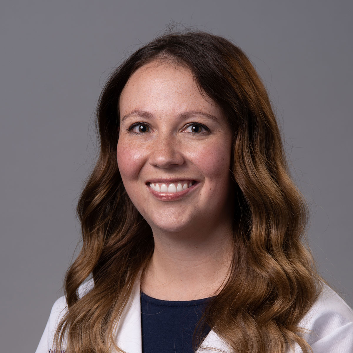 A friendly headshot of Dr. Kasey Woods