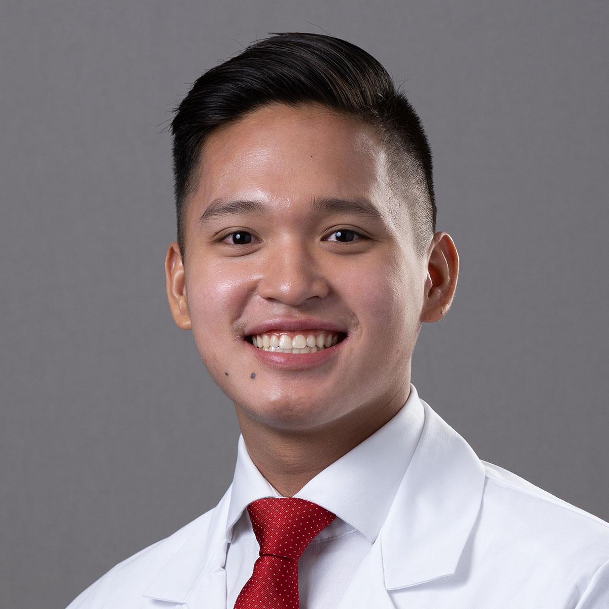 A friendly headshot of Dr. Louis Mercado