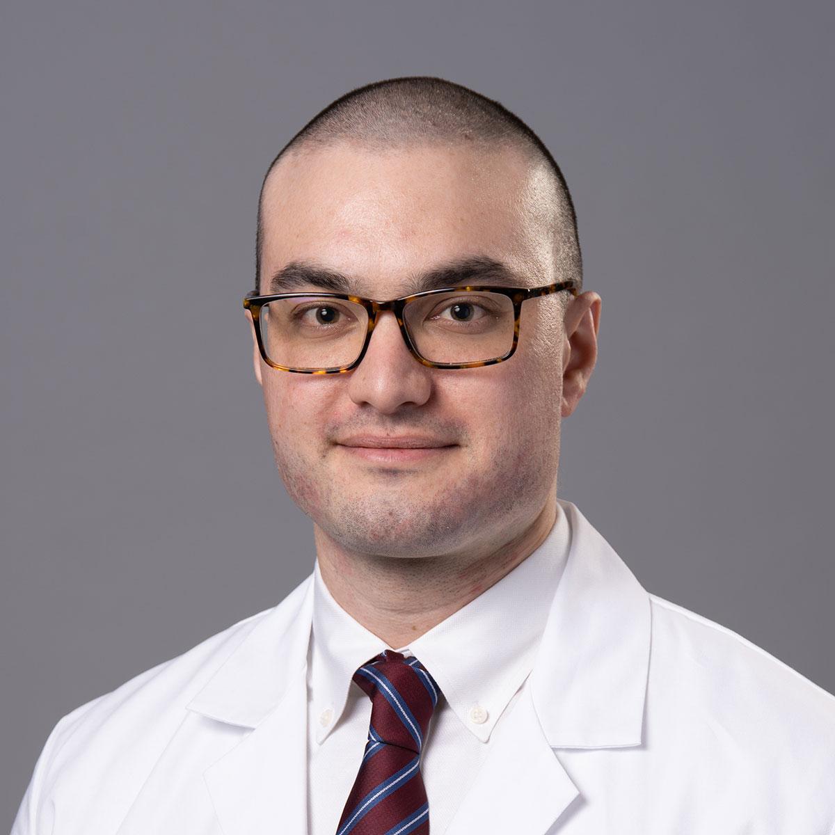 A friendly headshot of Dr. Lugman Croal-Abraham