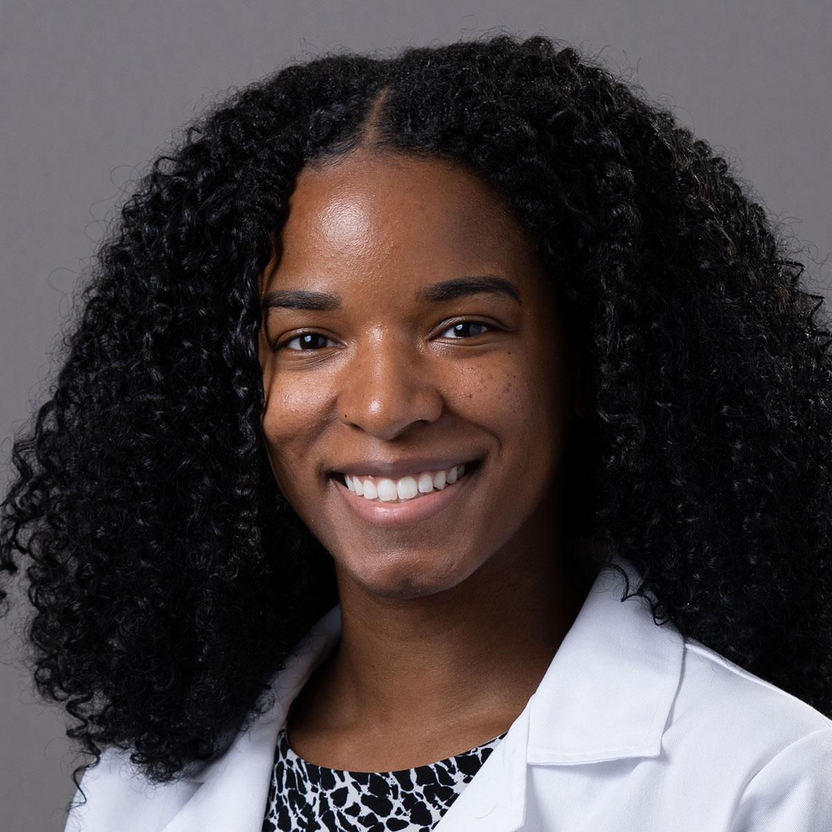 A friendly headshot of Dr. Malika Kelly