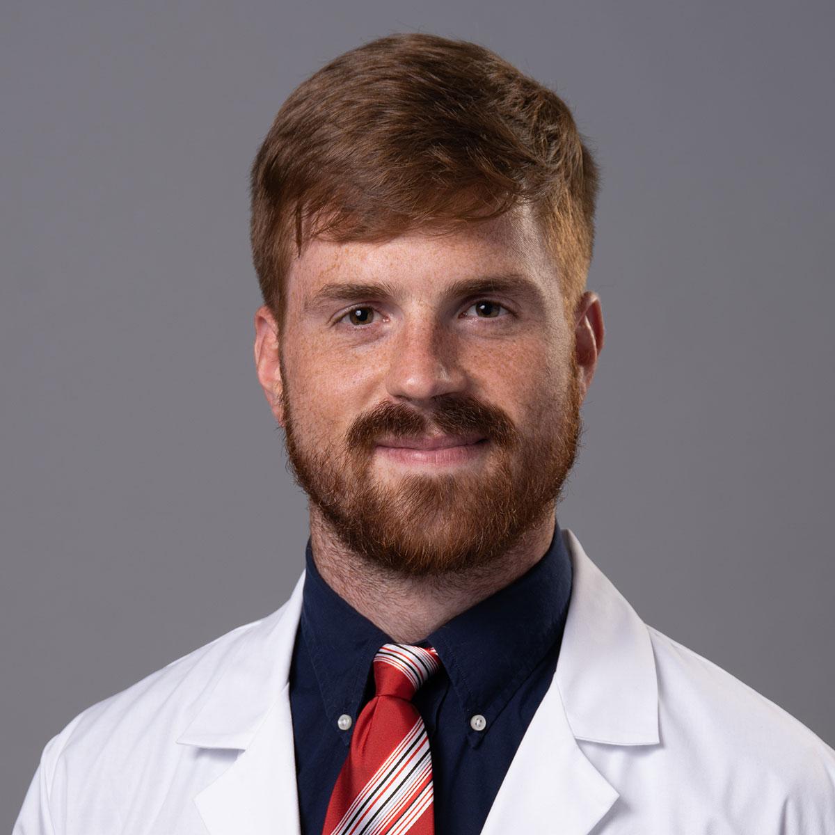 A friendly headshot of Dr. Ryan Parrish