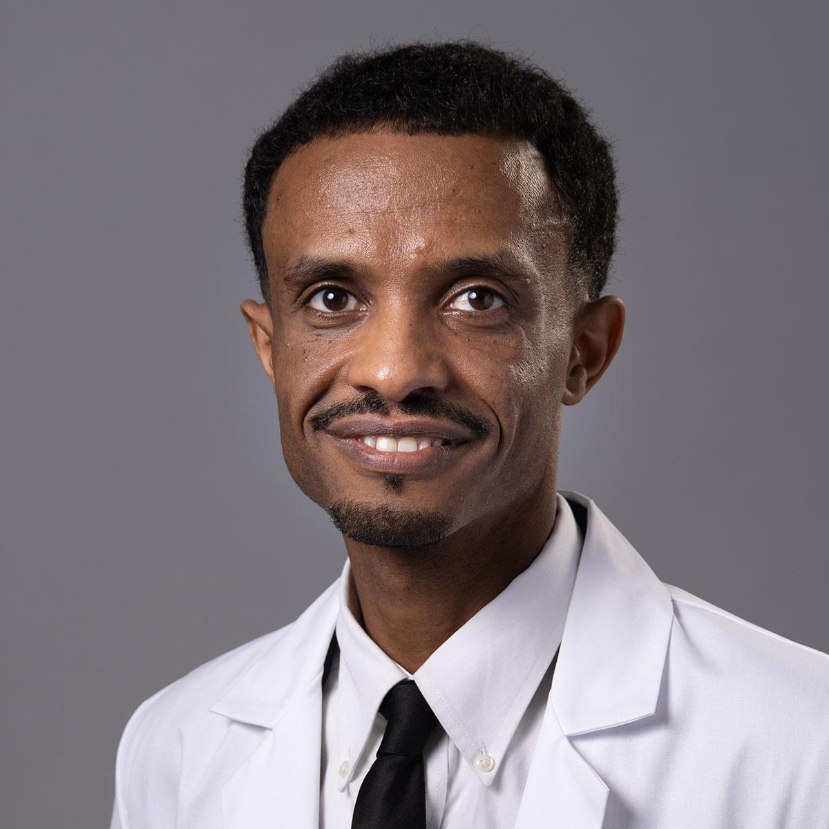 A friendly headshot of Dr. Tamene Yonas