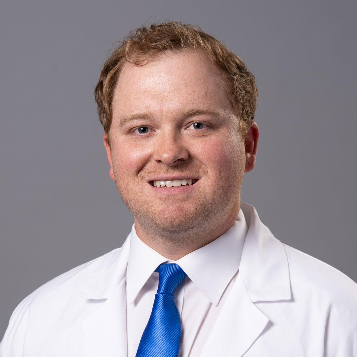 A friendly headshot of Dr. Thomas Godwin